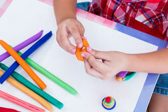 Close up child's hand moulding modeling clay. Strengthen the ima Royalty Free Stock Photography