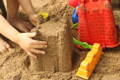 Close up of a child`s hand playing sand toys. stock photography