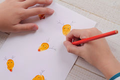 Close up on child's  hands making Christmas greeting card. Kids Art, Handmade Art Projects Stock Photo