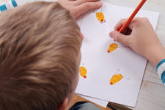 Close up on child's  hands making Christmas greeting card. Kids Art, Handmade Art Projects Stock Image