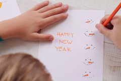 Close up on child's  hands making New Year greeting card. Kids Art, Handmade Art Projects Stock Images