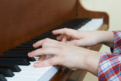 Close Up Of Child's Hands Playing Piano Stock Image