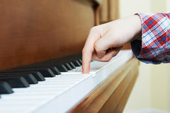 Close Up Of Child's Hands Playing Piano Royalty Free Stock Images
