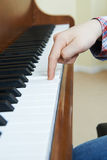 Close Up Of Child`s Hands Playing Piano Royalty Free Stock Images
