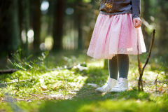 Close up of child`s leg in spring park. Cute little girl having fun during forest hike on beautiful spring day. Royalty Free Stock Photography