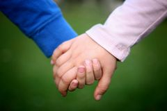 Close up of children hands. Two children holding hands, close up royalty free stock image