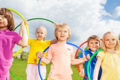 Close-up of children holding hula hoops in park Royalty Free Stock Photo