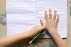 Close up Children are holding a pencil and writing. Stock Photography