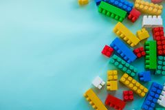 Close up Children plastic constructor. on a blue background stripe background. Developing toys.  Royalty Free Stock Images