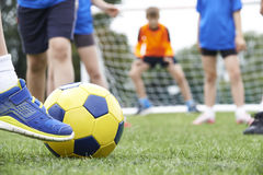 Close Up Of Children's Feet In Soccer Match Royalty Free Stock Image