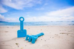 Close-up of children's toys on a white beach Royalty Free Stock Photo