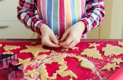 Close up of childs hands making christmas cookies royalty free stock photo