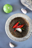Close up Chili and Garlic in Mortar Royalty Free Stock Photo