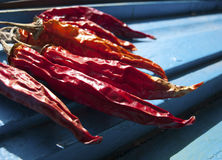 Close-up of chillies hang to dry Stock Photos
