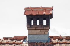 Close up chimney like a little house on the roof Stock Photos