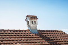 Close up chimney like a little house on the roof Stock Image