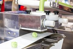 Close up chinese or asian food steamed stuffed buns on automatic belt conveyor of food making machine in production line for high. Technology industrial stock photos