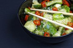 Close up of chinese broken cucumbers with sesame oil, pepper and garlic. Stock Image