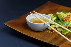 Close up of chinese broken cucumbers with sesame oil, pepper and garlic. Royalty Free Stock Photo