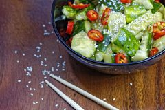 Close up of chinese broken cucumbers with sesame oil, pepper and garlic. Stock Photography