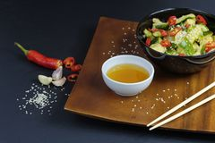 Close up of chinese broken cucumbers with sesame oil, pepper and garlic. Stock Photos