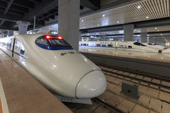 Close up of a Chinese fast train inside the newly opened high speed train station in Kunming. The new fast train station links Kun Stock Photo
