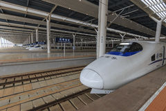 Close up of a Chinese fast train inside the newly opened high speed train station in Kunming. The new fast train station links Kun Stock Photos