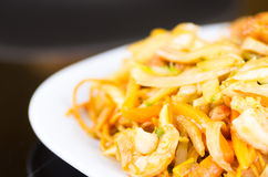 Close up of chinese food, vegetables and noodles with chicken on white dish Stock Photo