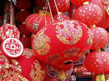 Close-up Chinese paper lanterns and decoration ornament for Chinese New Year Chinese characters mean blessing of health, wealth a Royalty Free Stock Photo