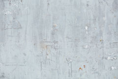 Close Up of Chipped blue peeling paint, torn ads Exterior Wall, Stock Photography