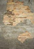 Close up of  chipped brick wall. /  peeling stucco Stock Image
