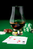 Close up of chips, cards and whisky glass on table Stock Photos