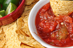 Close-up of Chips and Salsa and chile peppers Royalty Free Stock Images
