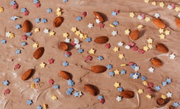 Close/up of chocholate cake with almonds and candies Royalty Free Stock Photos