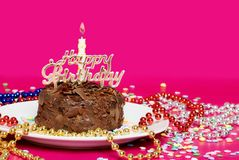 Close up of a chocolate birthday cake decorated royalty free stock photos