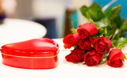 Close up of chocolate box and red rose flowers Stock Photography