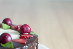 A close up of chocolate cake with cherries, strawberries, chocol Stock Photos
