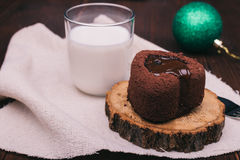 Close-up of chocolate cake, glass of milk and Christmas ball on Royalty Free Stock Photography