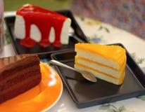 Close-up chocolate cake and strawbarry crape cake and orange cak Royalty Free Stock Images