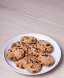 Close up of chocolate chip cookies on white plate and copy space Royalty Free Stock Photography