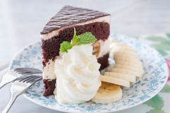 Close up of a chocolate cream cake on plate Royalty Free Stock Photos