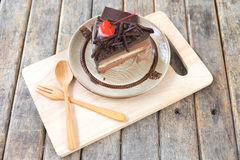 Close up chocolate layer cake with cherries topping Royalty Free Stock Photos