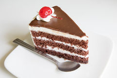 Close up chocolate layer cake with strawberry topping Stock Images