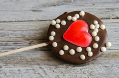Close-up of chocolate lollipop with heart jelly Royalty Free Stock Photos