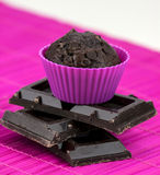 Close up of chocolate muffins on a wooden and pink placemat Stock Image