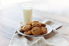 Close up of chocolate oatmeal cookies and milk Royalty Free Stock Photos