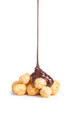 Close up of a chocolate syrup on a corn balls Stock Photos