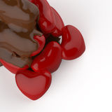 Close up chocolate syrup leaking over heart shape symbol Royalty Free Stock Photos