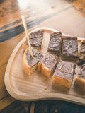 Close up chocolate topping toast on wooden plate Royalty Free Stock Images