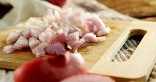 Chopped onion on chopping board 4k stock video footage